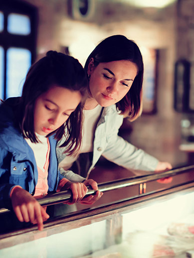 Mother and daughter visiting a museum