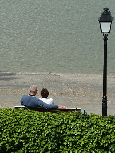 Lovers sitting on a bench in the Bay of Somme