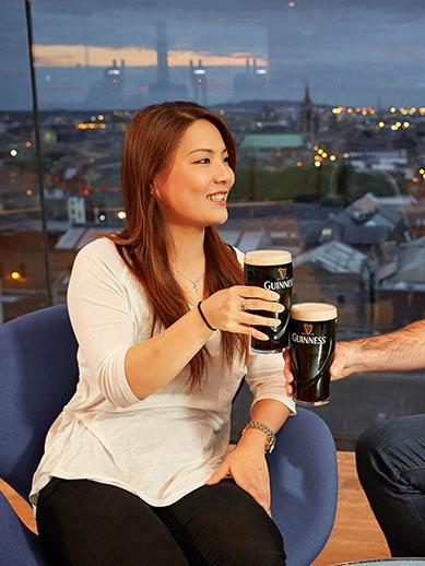 Girl drinking Guinness in the Gravity Bar, Dublin