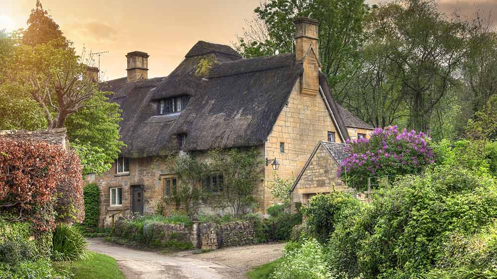 Thatched cottages in Cotswold, Gloucestershire in England