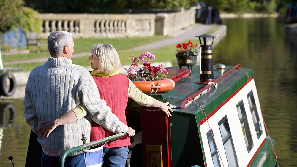 Couple hugging on a narrow boat