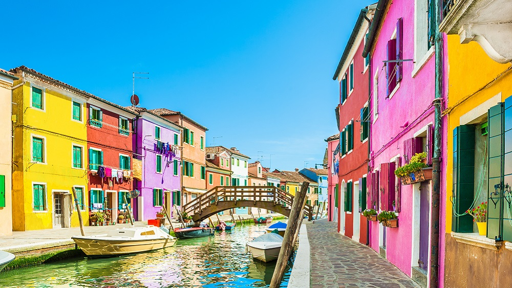 Colourful houses along a canal in Burano - Venice