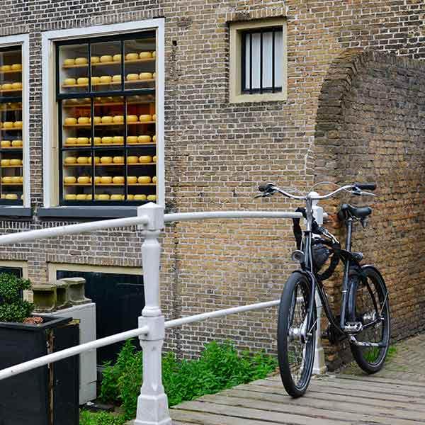 Bike on a bridge with old brickwork in Delft