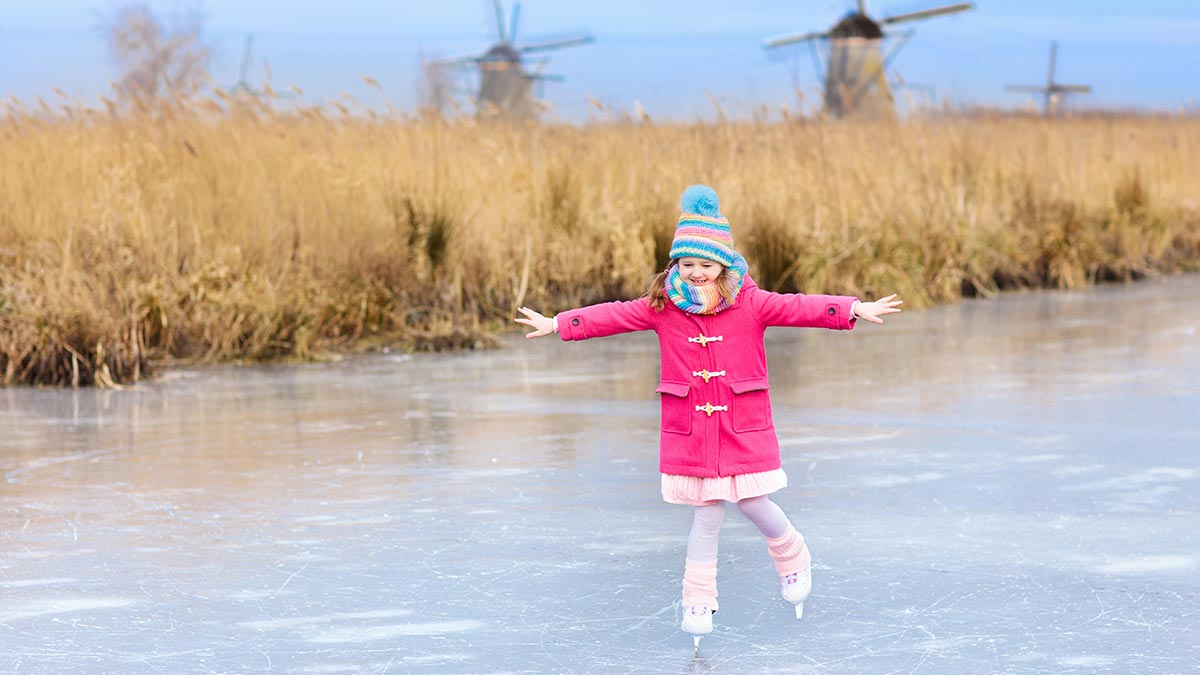 Child ice skating in Holland