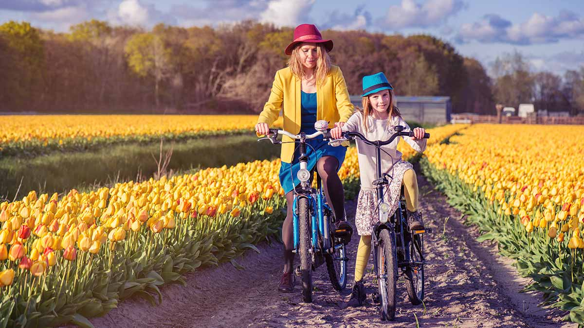 Mum and daughter riding a bike in Holland