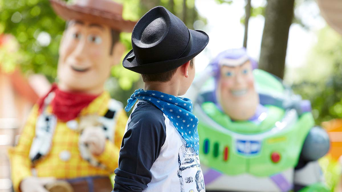 Child with Woody and Buzz from Toy Story at Disneyland