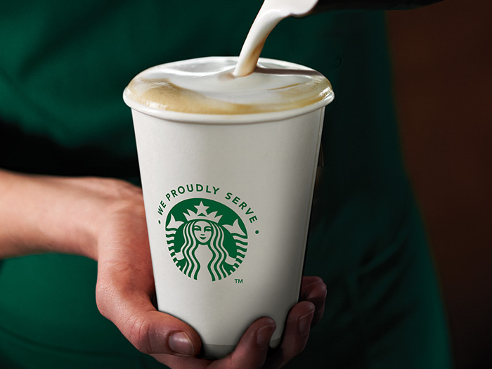 Starbucks cup milk pouring