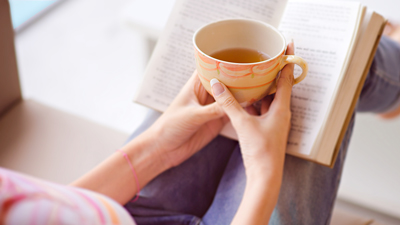 Quiet area - woman reading a book with a cup of tea
