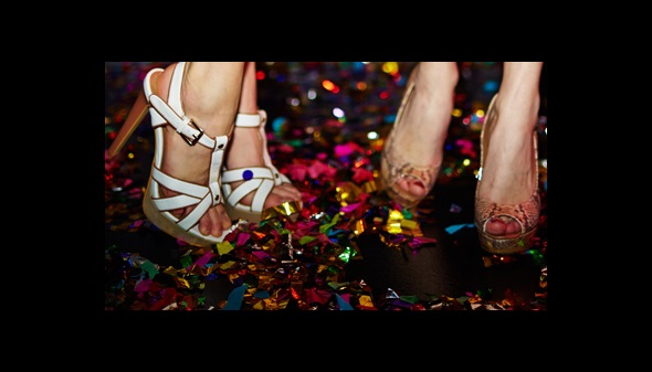 Sunset Show Bar - two girls dancing close up of their high heels with confetti