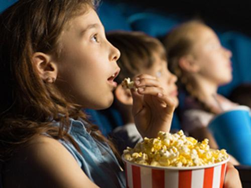 Kid watching a film in P&O Ferries cinema.