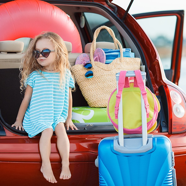 Child With Luggage In Car