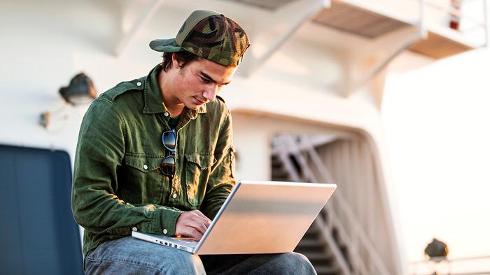 Man on laptop on ferry