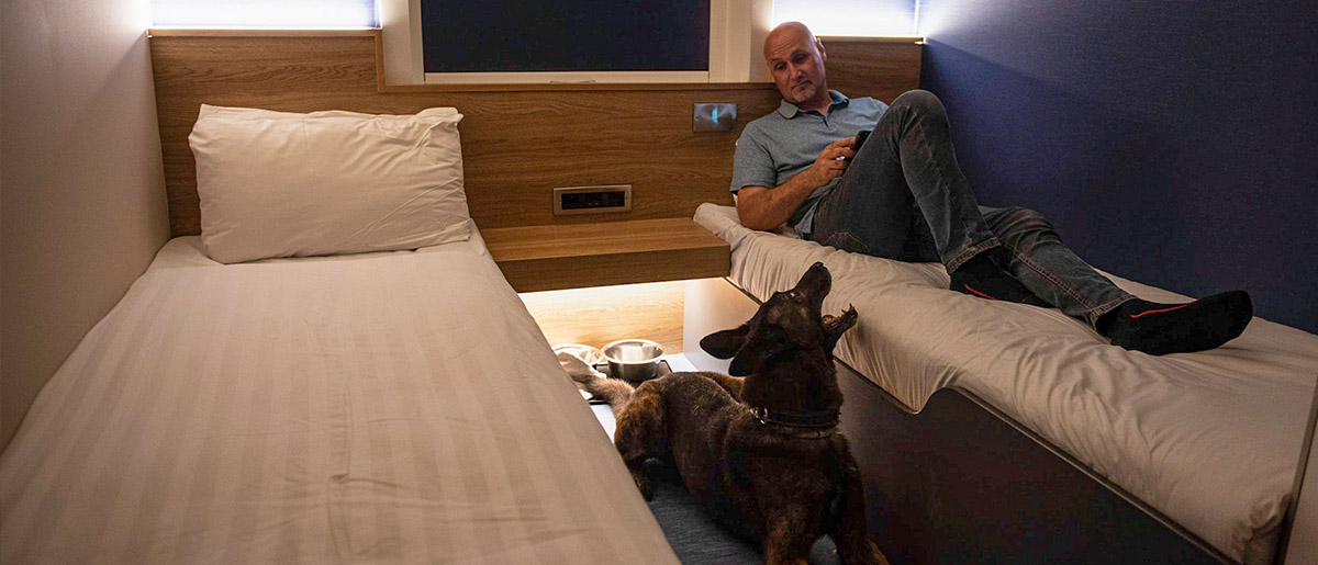 Dog and owner in Dog Cabin at night time on P&O Ferries